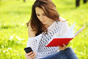 Image of young beautiful woman in park with book reading a messa