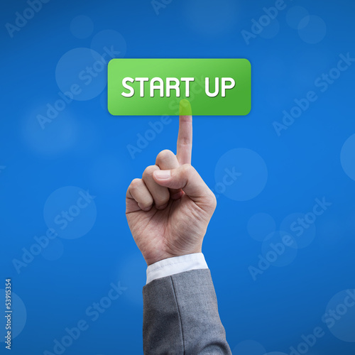 Start up business man press button