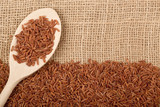 Brown rice on burlap fabric