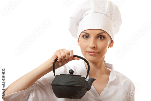 female cook / chef in uniform with teapot, isolated on white