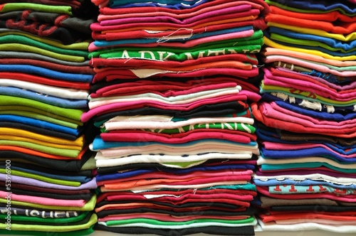 Tuinposter Stof Stack of Colorful t-shirt