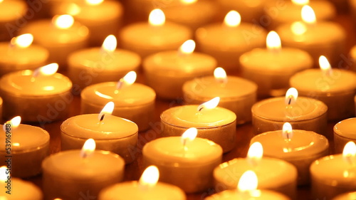 Close-up of many burning candles
