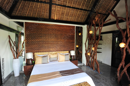 Interior of luxury tropical villa - bedroom