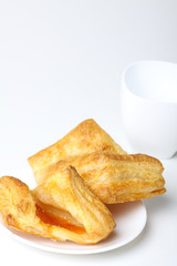 Breakfast with coffee and croissants on white background
