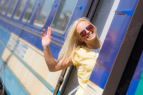 Woman Leaving for Vacation with Train