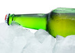 Close-up Green Beer Bottle with Condensation cool in ice isolate