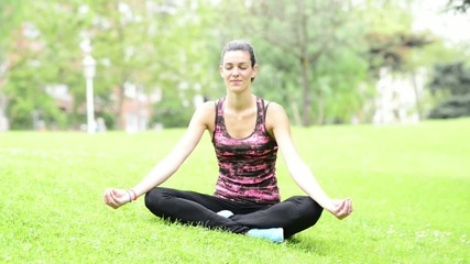 Woman Relaxing and Practicing Yoga in the Park.