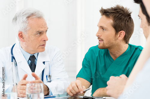 Doctors Discussing In Meeting