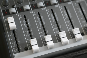 Audio mixer deck with knobs and selective focus