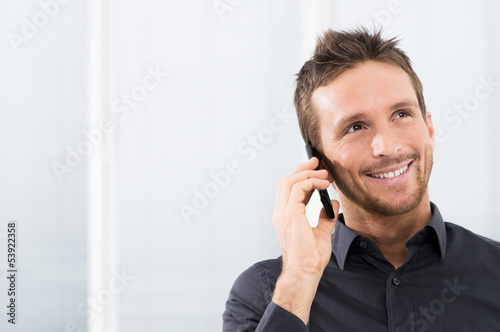 Happy Businessman On Mobile Phone