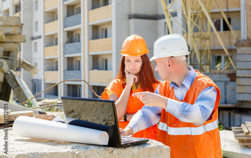 builders at work with a laptop