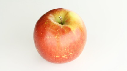 Fresh organic red apple. Rotating in studio lighting.