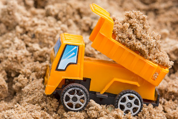 Dump truck unloads soil