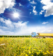 Lorry with trailer, meadow and blue sky