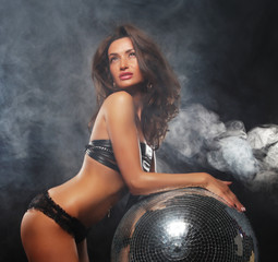 girl in smoke with disco ball
