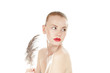 Beautiful young girl with a ostrich feather over white