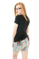Girl with lots of colored pencils and felt- tip in her pockets