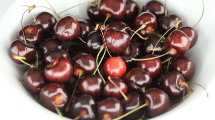 High angle view of bowl of cherries.