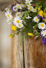 bouquet of wild flowers on a wooden background