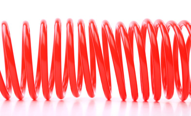 Plastic spring isolated on a white background
