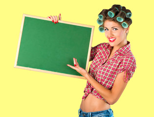 Housewife holding a blackboard over yellow background