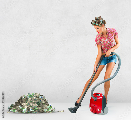 Housewife vacuuming