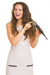 Happy young woman checking microphone