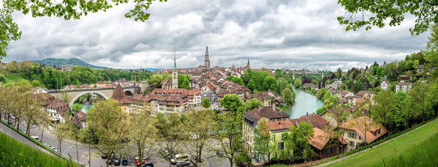 Church, bridge and houses with tiled rooftops, Bern