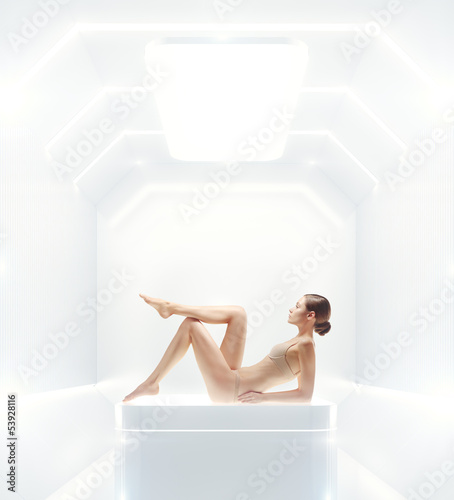 shining futuristic interior and young woman