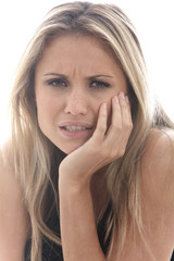 Model Released. Young Woman with Toothache