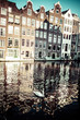 Amsterdam canal and bikes - 53929362