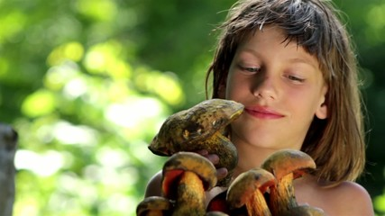 boy with a bunch of forest  mushroom