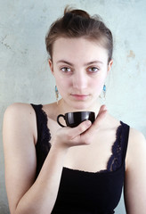 Woman with a black Espresso Cup