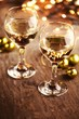 Wineglass with wine and Christmas ornaments