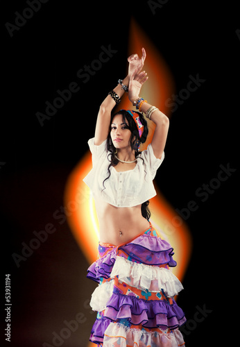 Dancing Gypsy girl with tongue of flame on black background