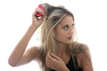 Model Released. Young Woman Brushing Tangled Hair