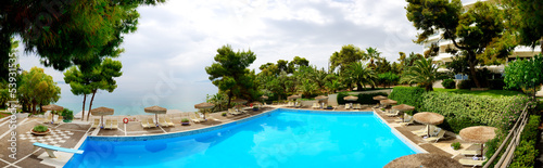 Panorama of swimming pool near beach at the luxury hotel, Pelopo
