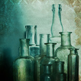 Vintage shabby chic background with old bottles