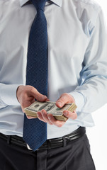Businessman holding bundle of dollar banknotes, closeup shot