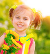 Happy little girl with sunflowers