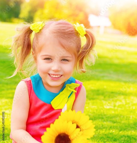 Little girl with sunflowers bouquet