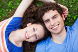 Young couple lying on grass
