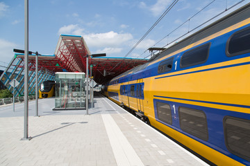 A train is leaving the central station of Lelystad, the Netherla
