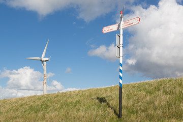 Wind turbine and traffic indicator for bicycles at a Dutch dike