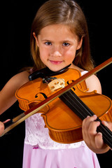 Girl playing violin in pink dress