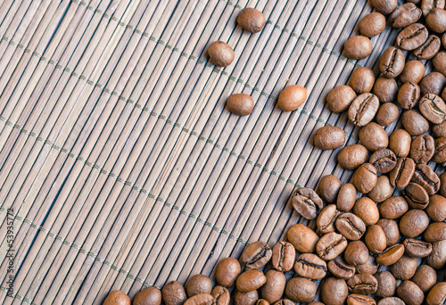 Coffee beans with bamboo background