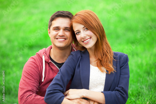 Couple at green grass.