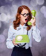 Women with green telephone
