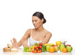 woman with fruits rejecting hamburger