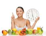 woman with fruits, vegetables and clock